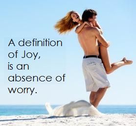 Joyful couple playing on the beach